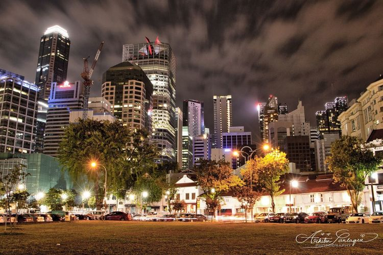 Skyscrapers Singapore Skyscrapers Nightshot Nightphotography Canon#instagram#instagramphoto Glowinthedark#canonshot Photography#photoshoot Photographylife#photolover Lights#singapore#nightlife Reflection#cityscape#vivid Canonphotography Longexposure Architecturedetail Phtography Photoshoot Night Illuminated Architecture Building Exterior Skyscraper City Built Structure Cityscape Tree Outdoors No People Travel Destinations Urban Skyline Sky