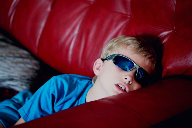 Boy Relaxing On Couch At Home