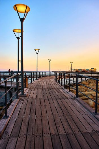 Light pathway Sky Street Light Street Sunset Water Pier Railing Clear Sky Nature Footpath Lighting Equipment Sea Wood - Material The Way Forward No People Tranquility