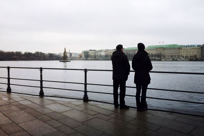 Water Real People Standing Two People City Looking At View Cityview Hamburgcity Hamburg Alster View Alster Alster Hamburg People Watching Melancholic Landscapes December In A Quiet Moment Cityscape Waterfront