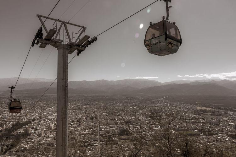 Overhead cable car against mountain range