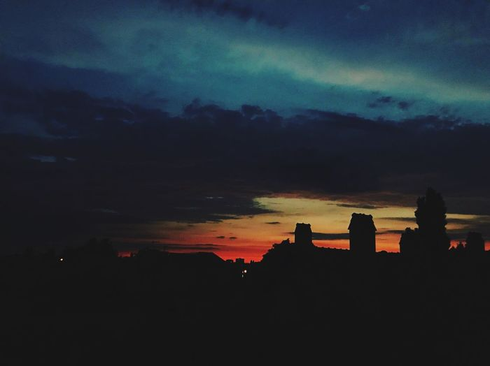 Silhouette Architecture Built Structure First Eyeem Photo Cloud - Sky Dark Travel Destinations Outdoors Scenics - Nature City Night Overcast Beauty In Nature Storm Building Silhouette Nature Sunset Dramatic Sky No People Sky Architecture Building Exterior