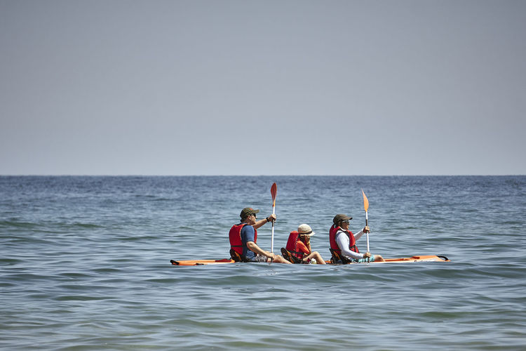 Adult Day Group Of People Holiday Horizon Horizon Over Water Leisure Activity Men Nature Nautical Vessel Oar Outdoors People Sea Sky Togetherness Transportation Trip Vacations Water