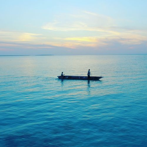 Nautical Vessel Sunset Outdoors Sea Water Horizontal Beauty In Nature People Nature Person Adult One Person Sky Day Astrology Sign Zanzibar Fisherman Catchingdinner Viewfromabove Dronephotography