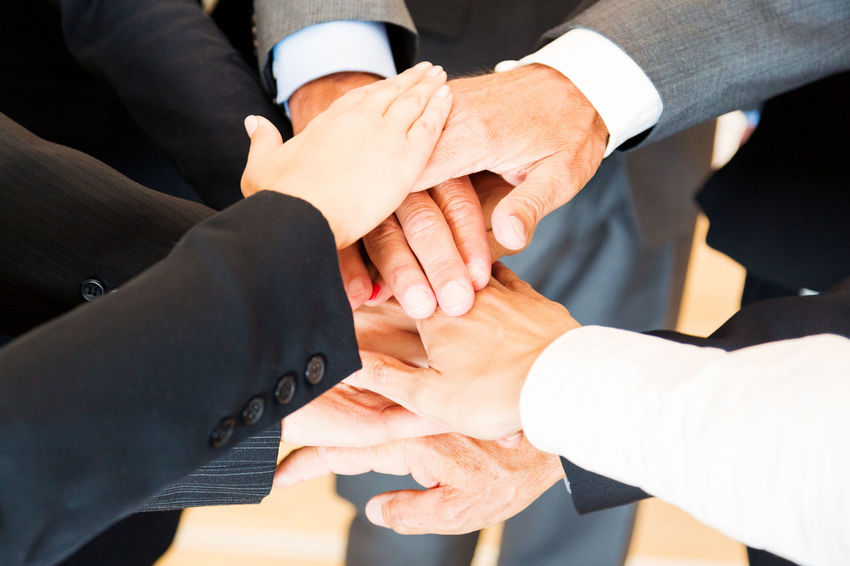 Business Company Office Teamwork Well Dressed Business Finance And Industry Business Person Businessman Businesswear Businesswoman Caucasian Group Group Of People Group Shot Human Hand Indoors  Men People Portrait Professional Team Teamwork Togetherness Women