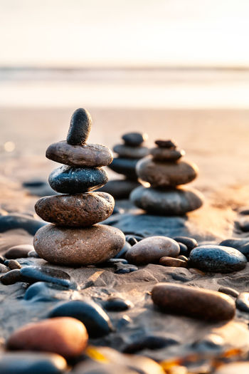 Close-up of stack of pebbles on beach