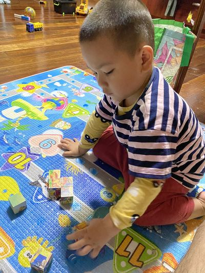 Full length of boy playing on table