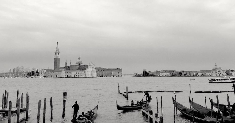 Boats in grand canal with buildings in background