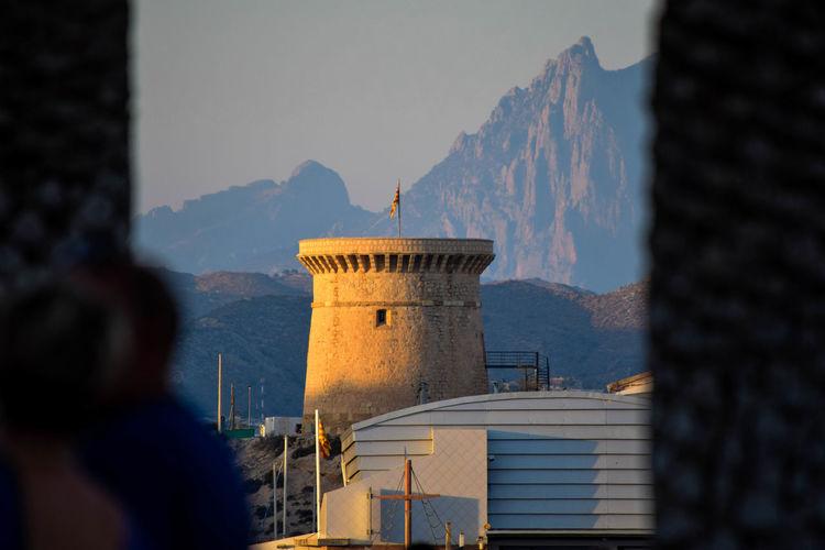 Tower Isleta Against Mountains Seen Through Window