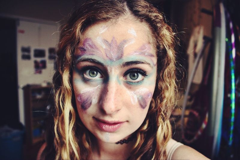 Portrait of young woman with face paint