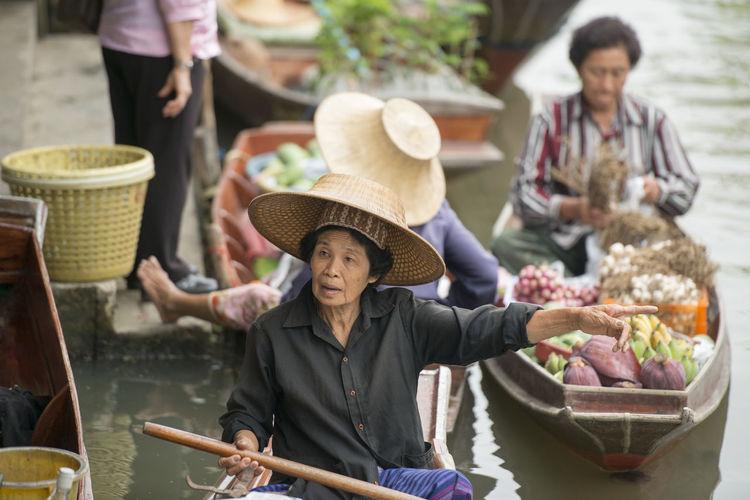 Vendors selling food at floating market