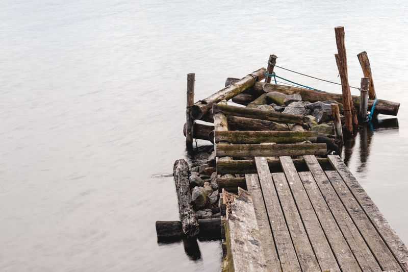 High angle view of abandoned pier on sea against sky