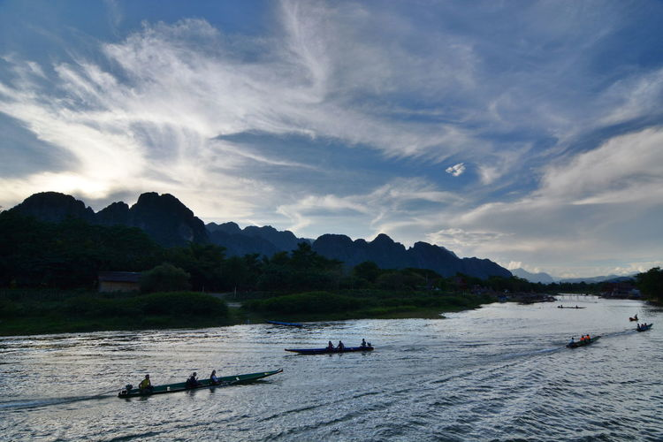 Cruising on Nam Song river. Vang Vieng. Laos Nam Song River River View Riverside Vang Vieng Vang Vieng, Laos Beauty In Nature Cloud - Sky Group Of People Laos Mode Of Transportation Mountain Nam Song Nature Nautical Vessel Outdoors River Scenics - Nature Silhouette Southeast Asia Southeastasia Transportation Travel Destinations Vientiane Province Water Waterfront