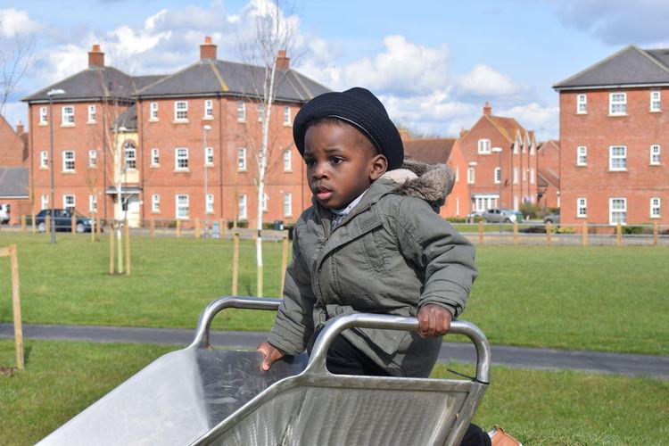 Cute boy on slide at playground