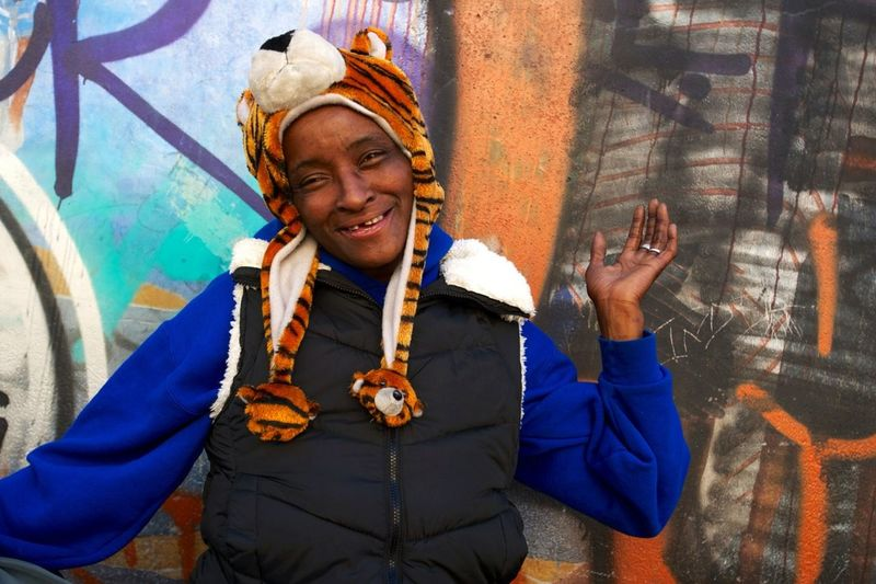 Pinky's Hair is blue, but when she thought a picture might happen, she pulled a tiger hat from her shopping cart of belongings, covering her head. Originally from Cleveland, she came to LA, following a guy. He was an asshole, she says. She likes LA, th