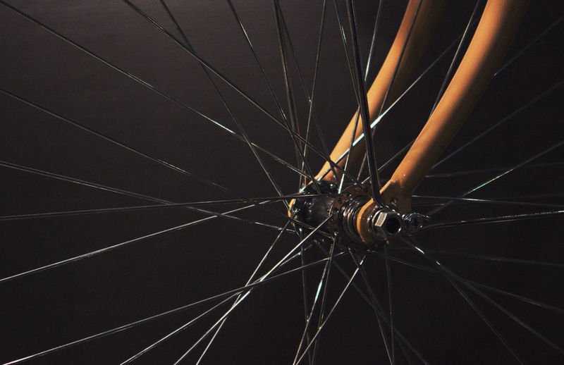Full frame shot of bicycle wheel against black background