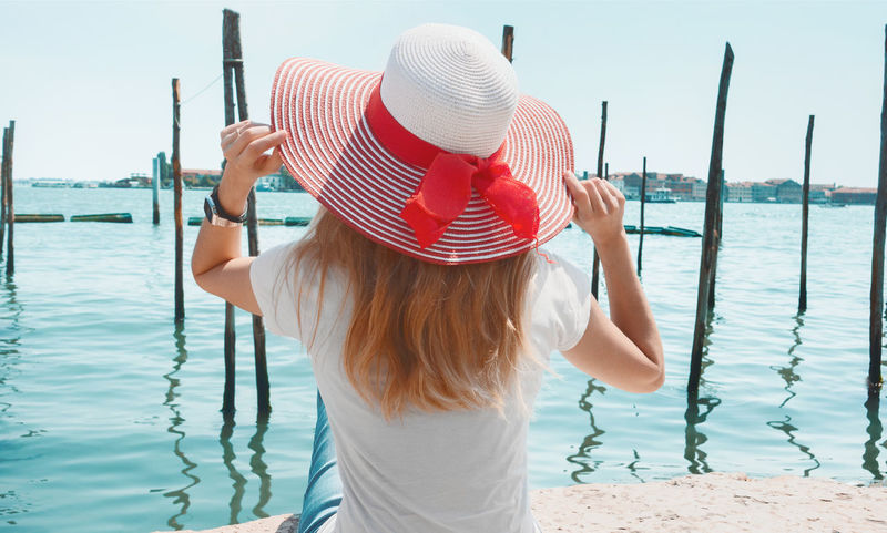 Young woman in Venice, background or banner Blonde Fashion Laguna Perfect Day Red Hat San Marco Square Sunny Vacations Venice, Italy Woman Background Blur Blurry Girl Holydays Italian Italian Architecture Outdoors Perfect Relax Relaxation San Marco Venezia Sea Venice Young Women