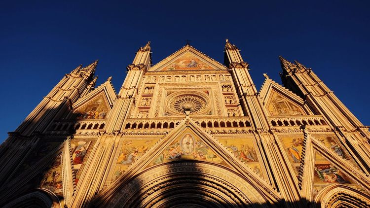 Umbria Duomo Church Religion Low Angle View Built Structure Place Of Worship Rose Window Building Exterior Blue Spirituality Clear Sky Façade No People Sky Outdoors Day Orvieto Orvieto, Italy