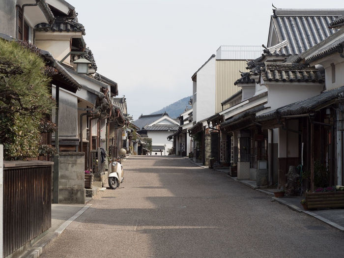 Old Town Alley Architecture Building Building Exterior Built Structure City Clear Sky Day Diminishing Perspective Direction Footpath House Japanese Good Old Town Long Nature No People Outdoors Plant Residential District Sky Street The Way Forward Town Udatsu No Machin