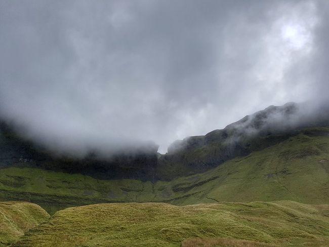 Dramatic cloudy sky over Benwiskin mountain in Gleniff horseshoe drive, Sligo, Ireland. Landscape Green Dramatic Cloudy Mist Mountain
