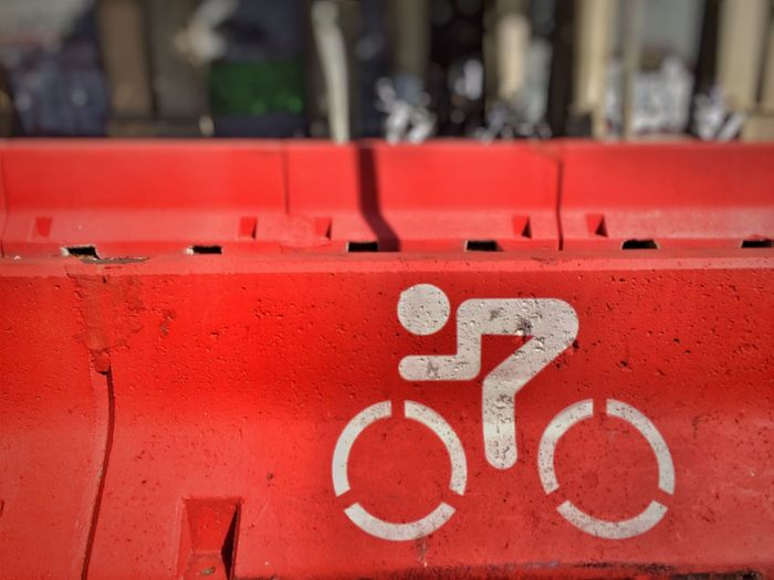 Close-Up Of Bicycle Lane Sign On Wall