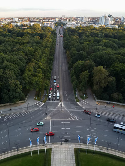 High Angle View Of Cars On Street Amidst Trees Against Sky