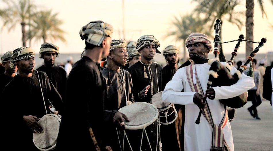 Musicians in traditional clothing performing on street