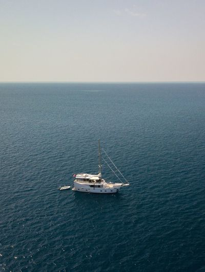 High angle view of sailboat sailing on sea against sky