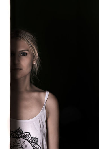 The Line series The Portraitist - 2017 EyeEm Awards The Week On EyeEm Beautiful Woman Black Background Blond Hair Fashion Model Front View Indoors  Light And Shadow Looking At Camera Portrait Real People Young Adult
