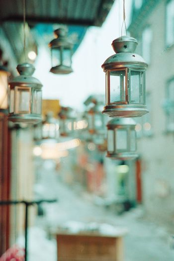 Close-up of lantern hanging in glass