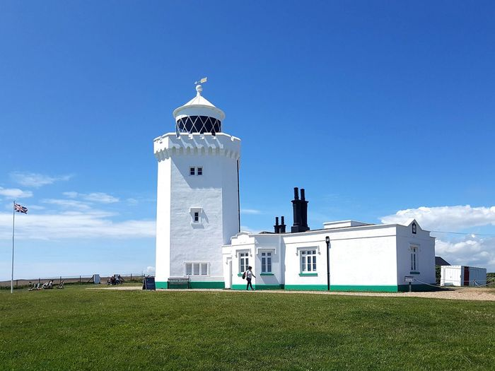 View of lighthouse against buildings