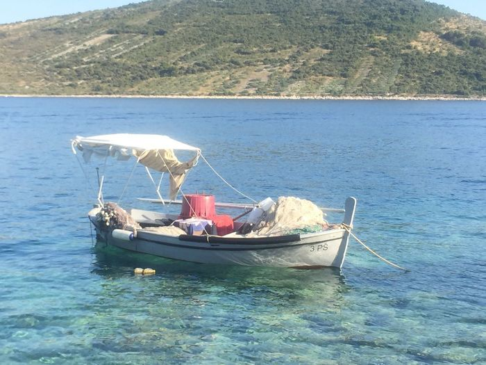 Travellingphotography Summer Blue Water Timestop Silence Moment Mediterranean  Fisherboat Boat Biat Tranquility Water Transportation Mode Of Transport Nature Nautical Vessel Day Sea Scenics Waterfront Beauty In Nature Outdoors Mountain No People Outrigger