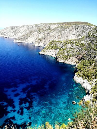 Clear Sky Sky No People Blue Sea Water Rock - Object Nature Beach Beauty In Nature Outdoors Scenics Landscape Day Mountain Campi Bay Zakynthos,Greece Travel Destinations Greece Shadow Tranquility Beauty In Nature Sand Islandlife