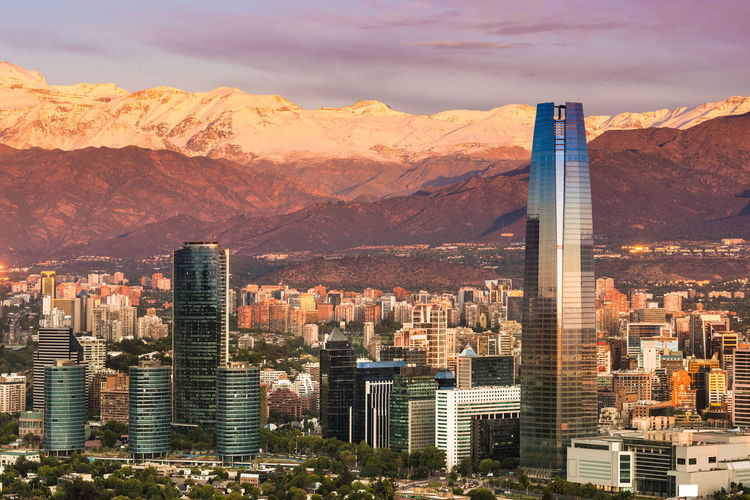 Skyline of Santiago de Chile at the foots of The Andes Mountain Range and buildings at Providencia district. Architecture Business Chile Chilean  Cityscape Las Condes Latin America Los Andes Modern Providencia Sanhattan Santiago De Chile Skyline Skyscrapers Buildings Cordillera De Los Andes Corporate Buildings District Evening Latin American Mountain Range Office Buildings Santiago Sunset Wealthy