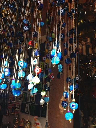 Showcase Screen Shop Color Light Streetphotography Turkey Evil Eye Blue Beads Beads Illuminated Decoration Hanging Night Celebration Holiday Art And Craft Large Group Of Objects Multi Colored Retail