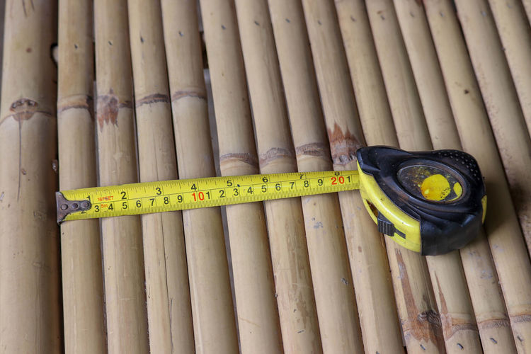 High angle view of tape measure on bamboos