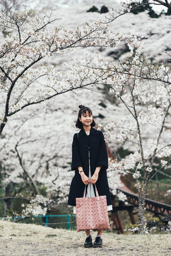 Sakura in my heart Tree Real People Front View One Person Plant Nature Standing Young Adult Lifestyles Day Young Women Leisure Activity Three Quarter Length Full Length Branch Casual Clothing Looking At Camera Portrait Women Outdoors Cherry Blossom Springtime Cherry Tree Beautiful Woman Sakura