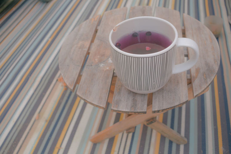 EyeEm Selects High Angle View Drink No People Indoors  Close-up Day Healthy Eating Food Freshness Food And Drink Multicolored Red Fruits Berries Healthy Drink Mug Wood - Material Table Fruit Water Wintertime Hot Drink Healthy Lifestyle Rustic Style Cosy Time