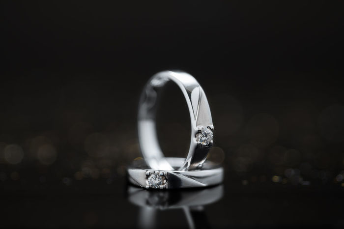 Groom Luxurylifestyle  Platinum Wedding Black Background Bokeh Both Bride Close-up Closeup Cople Daimond Diamond Ring Engagement Ring Jewelry Luxury Precious Gem Ring Selective Focus Single Object Soulmate Wedding