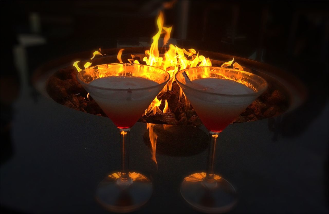 alcohol, drink, no people, food and drink, refreshment, cocktail, martini glass, close-up, flame, wine, night, outdoors, martini, illuminated, freshness, wineglass