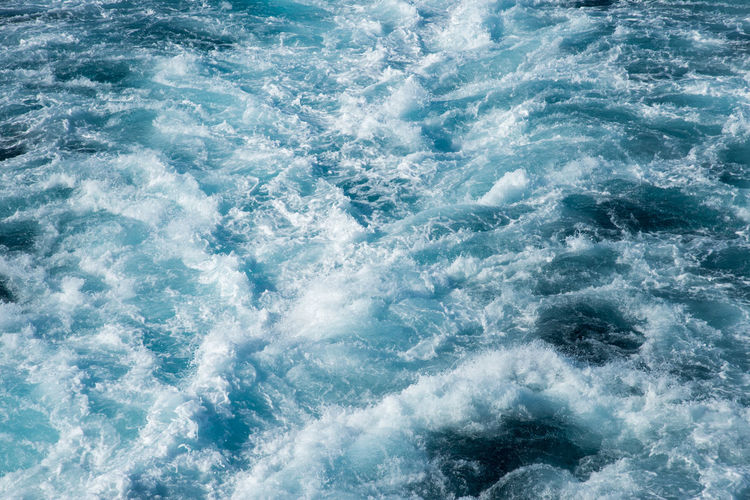 Cruise boat wake in the Pacific Ocean waters of Fiji Fiji Islands Flowing Water Backgrounds Beauty In Nature Blue Close-up Fiji Foamy Full Frame Island Motion Nature Oceania Outdoors Pacific Ocean Power In Nature Sea Surface Level Texture Wake Wake - Water Water Water Surface Water_collection Wave