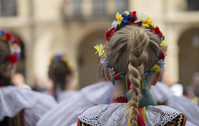 Rear view of women wearing flowers