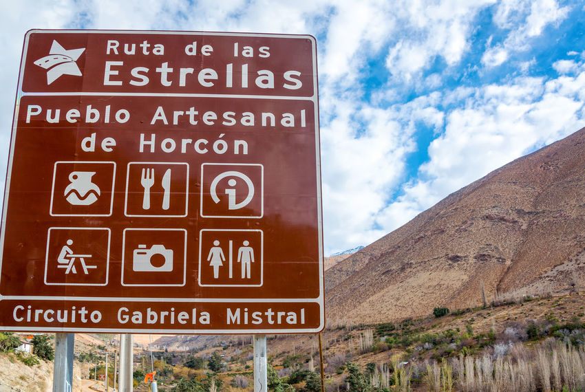 Street sign near Vicuna, Chile on the route known as the Gabriela Mistral Circuit Arid Arid Climate Blue Chile Desert Elqui Elqui Valley Gabriela Mistral Mountain Outdoors Pisco Elqui Road Sign Signboard Sky South America Text Tourism Travel Travel Destinations Valley Vicuña Vicuña, Chile