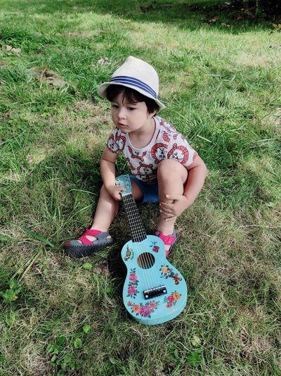 Full length of boy wearing hat on field