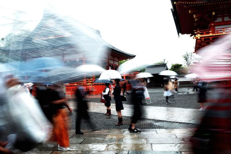 Rainy #FREIHEITBERLIN Everydayeverywhere Japan Streetphotography FilipinoStreetPhotographers EyeemPhilippines Colors Motion City Blurred Motion Street Wet Architecture Group Of People City Street Walking