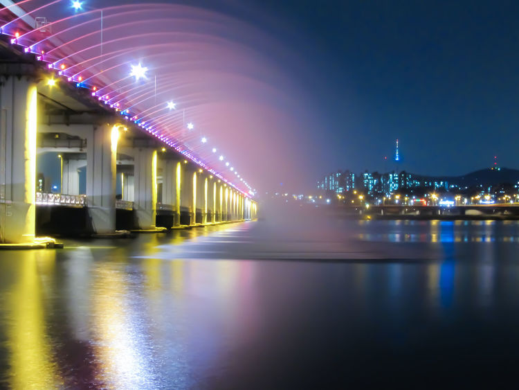 Banpo Bridge Rainbow Fountain (the world's longest bridge fountain recognized by the Guinness Book of World Records) Architecture Banpo Hangang Park Banpodaegyo Bridge Bridge Fountain City Electric Light Found On The Roll Fountain Hangang Illuminated Longest Fount Longest Fountain Modern Night No People Pink Color Rainbow Fountain River Seoul Seoul Hangang Waterfront 강 서ㅜㄹ 한강