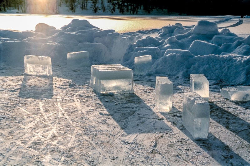 Solid, transparent ice blocks standing on frozen water on a cold, frosty winter day BIG Blocks Frozen Ice Sunlight Arctic Block Blue Clear Cold Create Freeze Ice-cold Ice-cube Iced Icy Lake Large North Rectangle Solid Symbol Temperature Transparent Water