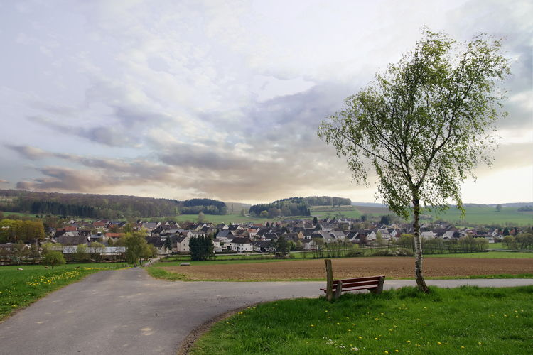 A view of Vielbach, a small village in Westerwald, Germany Bench Grass Path Travel Tree Vielbach Clouds Germany Landscape Sky Summer Town Valley Viewpoint Village Westerwald