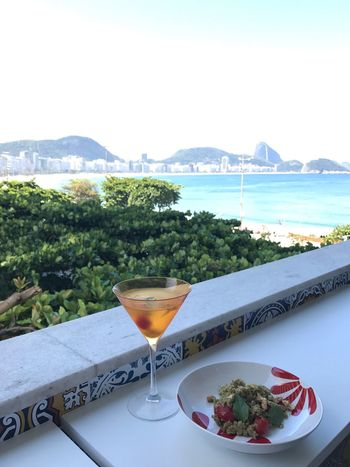 Sea Cocktail Alcohol Martini Glass Food And Drink Beach Scenics Clear Sky Drinking Glass Martini Drink No People Mountain Mojito Nature Outdoors Sky Water Day