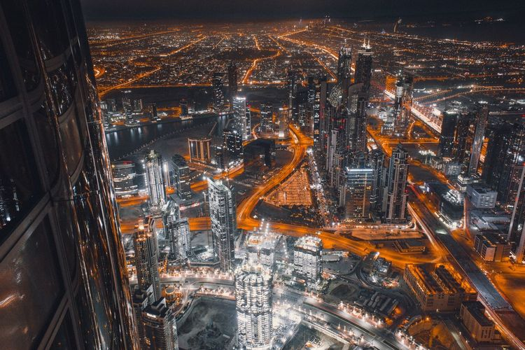 Dubai Illuminated Night No People Transportation Glass - Material Backgrounds Full Frame Architecture Outdoors Glass Drop Window High Angle View Refreshment Mode Of Transportation Orange Color Cityscape